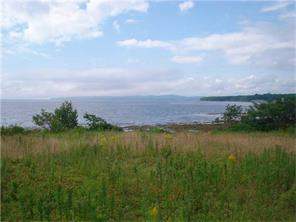 Beautiful oceanfront lot with vsoutherly views of Penobscot Bay for sale in Searsport Maine
